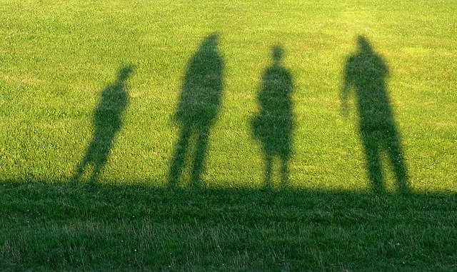 Shadow of family on sports field