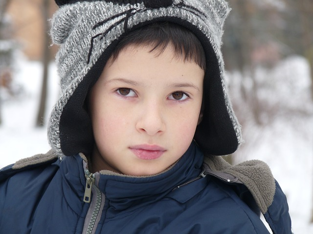 child in winter jacket and hat