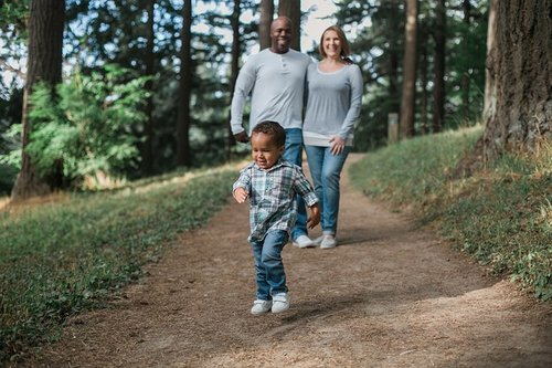Ways for a family to save money - parents and child hiking