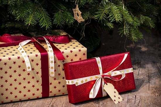 Wrapped Christmas presents under tree - Christmas gift ideas for extended family